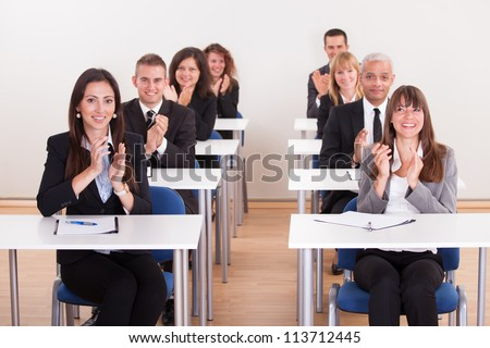 Group Businesspeople Raising Their Hands In Meeting