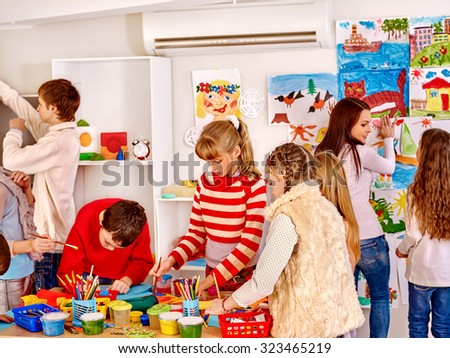 Group children painting at art school. Education.