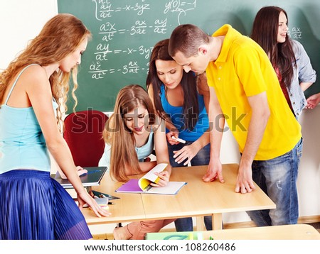 Group clever student near blackboard in classroom.