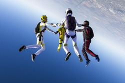 Group collects figure skydivers in freefall.