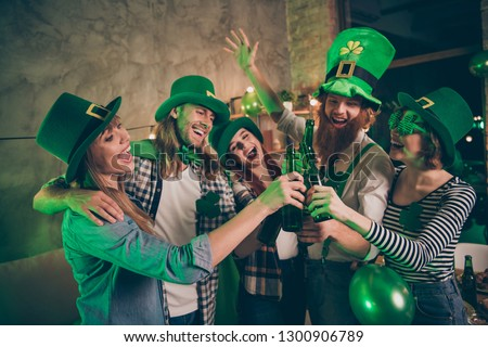 Group company cheerful five members green tradition culture national carefree lucky leaf style specs hats listening toast decorated room place flat house casual shirt jeans clothes scream shout song