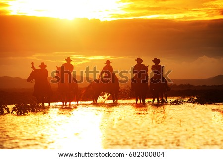group cowboy  on horseback ...