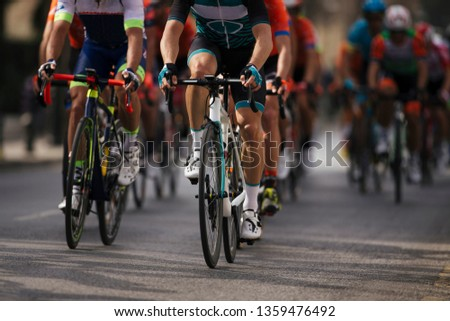 Group cyclist professional in a race.