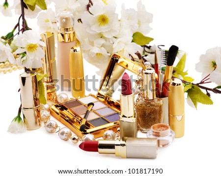Group decorative cosmetics and flower. Isolated.