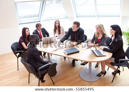 group discussion on a business meeting in a modern office