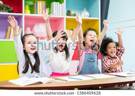 Group diversity kids studying at school, rising hands and enjoy in classroom, kids education concept