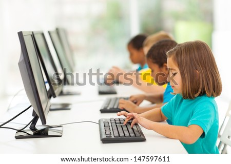 group elementary school students in computer class - stock photo