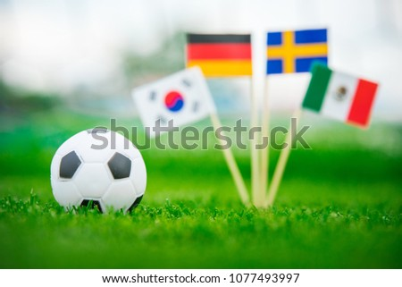Group F and football ball on green grass. National Flags of Germany, Mexico, Sweden, Korea Republic, South Korea #1077493997