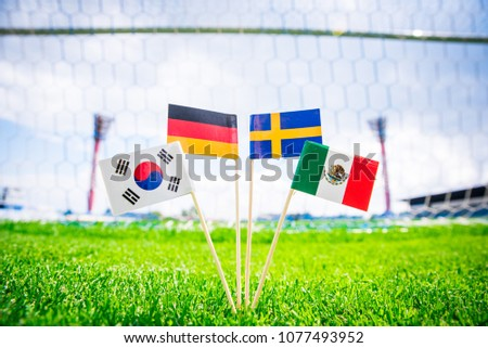 Group F - Germany, Mexico, Sweden, Korea Republic, South Korea - National Flags on green grass on football stadium #1077493952