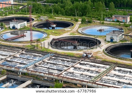 Group from the big sedimentation drainages on sewage water recycling station. - stock photo