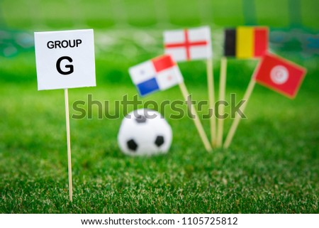 """Group G - National flags of Belgium, Panama, Tunisia, England in Russia. Table with title """"Group G"""" National flags in background #1105725812"""