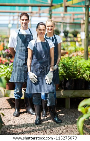 group gardeners portrait in greenhouse
