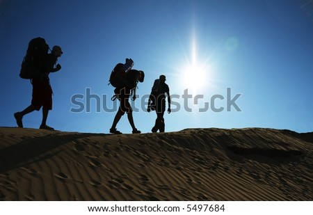 Group going  in sand desert