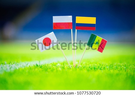 GROUP H draw in Russia 2018  - Poland, Senegal, Columbia, Japan national Flag and football ball on green grass. Fans, support photo, edit space. Original wallpaper for Football World Cup, Russia 2018 #1077530720