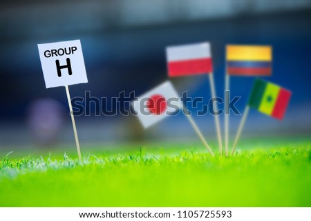 """Group H - National flags of Poland, Senegal, Columbia, Japan in , edit space. Table with title """"Group H"""" National flags in background #1105725593"""