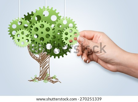 Group. Hand hold green tree of industrial gear, environmental concept