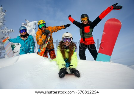 Group happy friends having fun at Sheregesh ski resort. Skiers and snowboarders team concept