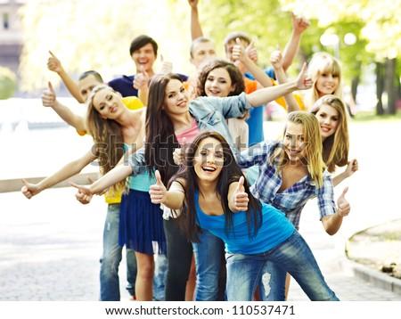 Group happy people in summer outdoor.