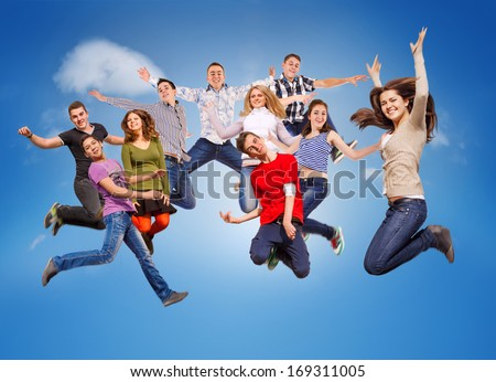 Group happy young people jumping in sky