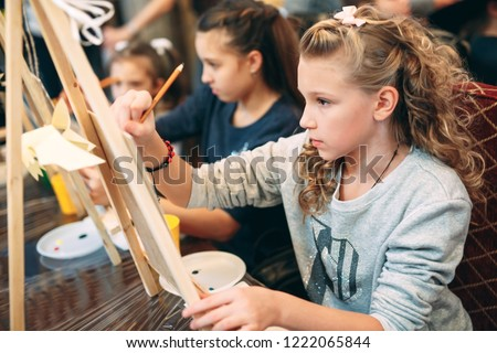 group lesson in drawing. Children learn to draw in the classroom. #1222065844
