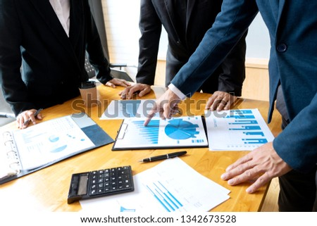 group meeting in the room have lcd screen on the wall , teamwork about data analyses business or stock market #1342673528