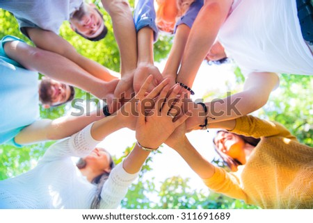 Group of a friends hands together