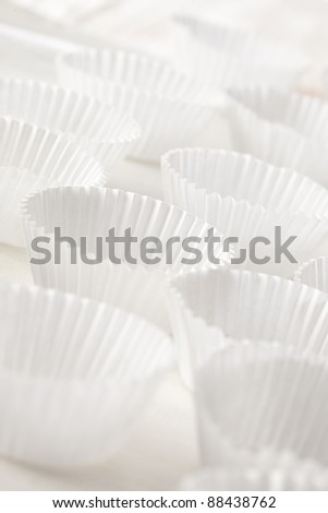 Group of a white and clean cupcake liners with natural light.