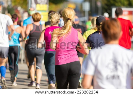 Group of active people running in the city. Healthy lifestyle. Weight Loss. Urban marathon run.