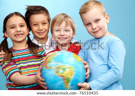 Group of adorable boys and girl with globe