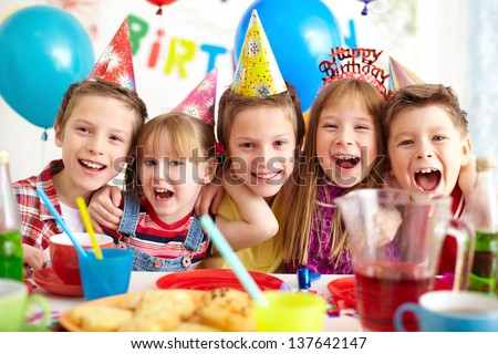 Group of adorable kids having birthday party