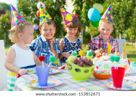 Group of adorable kids having fun at birthday party  #153852671