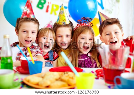Group of adorable kids looking at camera at birthday party #126176930