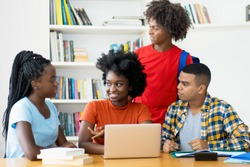 Group of african american and latin students coding app at computer at classroom of university