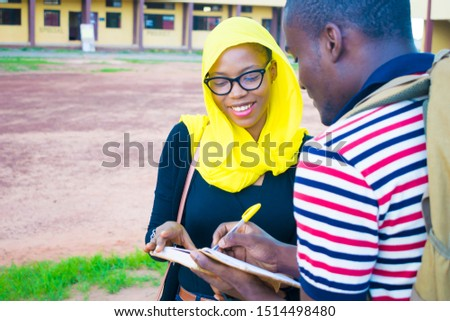 Group of African students studying in a public outside  library