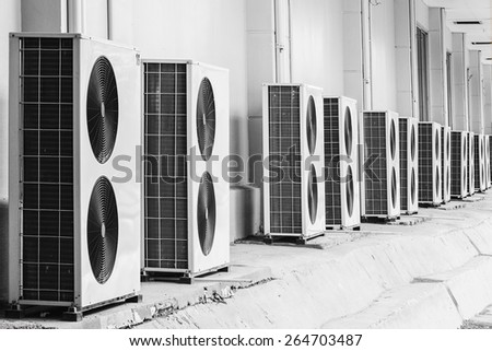 Group of air conditioner outdoor units outside of building
