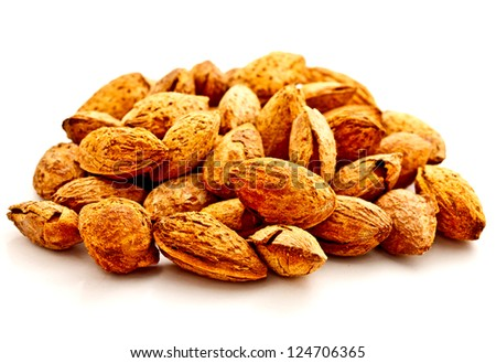 group of almond nuts on white background