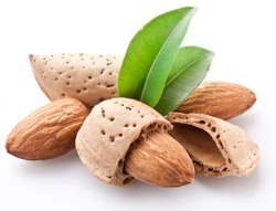Group of almond nuts with almond leaves. Isolated on a white background.
