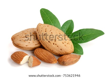 Group of almond nuts with leaves isolated on a white background. #753621946