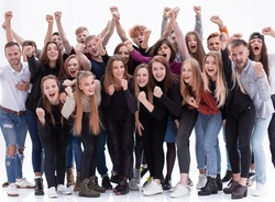 group of ambitious young people showing their success