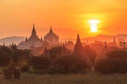 group of ancient pagodas in Bagan at the sun set, myanmar