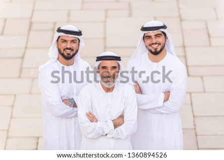 Group of arabian businessmen with kandura meeting outdoors in UAE - Middle-eastern men in Dubai