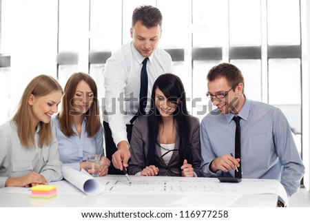 Group of architects working at office.
