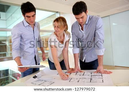 Group of architects working in office