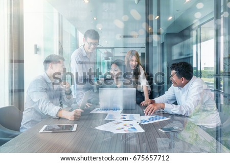 Group Of Asian and Multiethnic Business people with casual suit working and brainstorming together with technology computer in the modern Office, people business group and entrepreneurship concept.