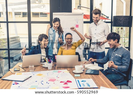 Group Of Asian and Multiethnic Business people with casual suit working with happy action and celebrate in the modern Office, people business group concept