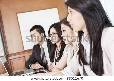 Group of Asian business people listening in a meeting season