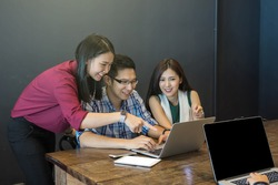 Group Of Asian Business people with casual suit brainstorm Meeting with technology equipment In the modern coffee shop,business group concept