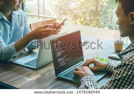 group of Asian developer programming and coding on laptop technology. Website design Safety of the social world Cyberspace concept.
