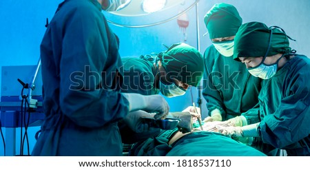 Group of asian doctor and nurse surgeons in hospital operating theater. Medical team performing surgery in operation room.Medical team doing critical operation.health and wellness concept Stock photo ©