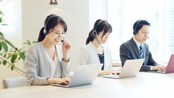 Group of asian operator. Call center. Customer support.